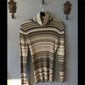 Grey, white and black striped turtleneck sweater